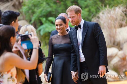 지난해 '라이온 킹' 프리미어에 참석한 英 해리 왕자 부부 [EPA=연합뉴스]